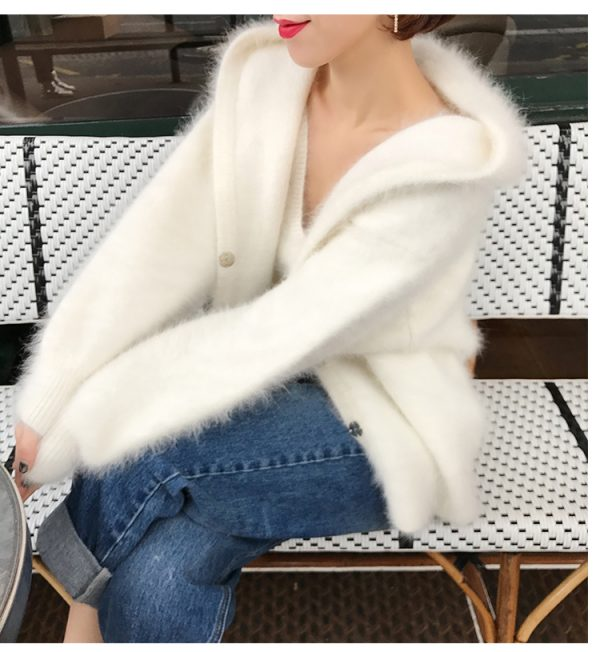 Woman wearing Cashmere Sweater while holding Purse